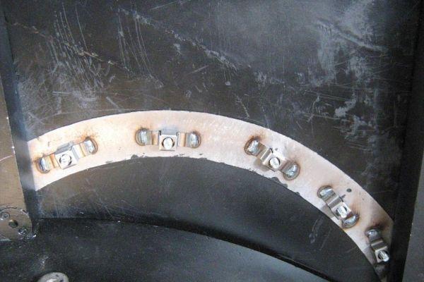 close-of-caged-nuts-and-bracing00083B34-9CD0-EDD4-E541-41E101F0135F.jpg
